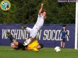 Not a PK: Blake Hylen of SDSU gets away with this grab against Washington's Jacob Hustedt. Later the Huskies scored two late goals to win. (Stephanie Brownfield)