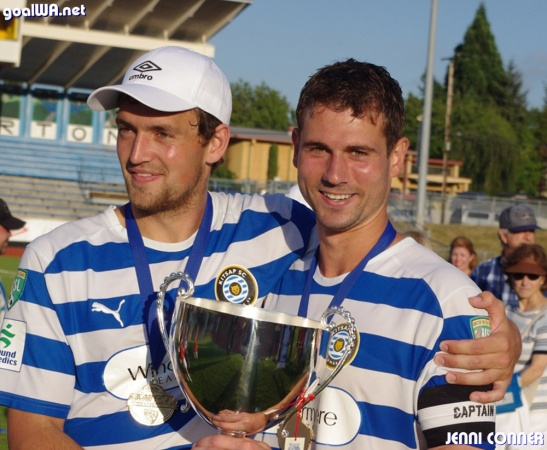Taylor Hyde and Daniel Scott hold the 2011 PDL National Title trophy. (Jenni Conner)