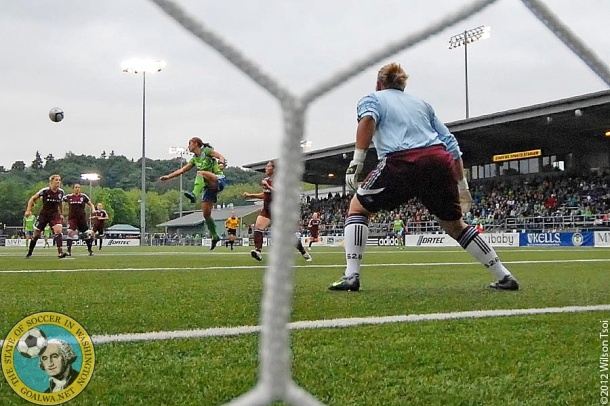 June 04, 2012, Tukwila, Wa. - Sounders forward Alex Morgan starts her ascent for a header that yields Seattle's go-ahead goal just 3' after kickoff.  W-Sounders defeat the previously unbeaten Colorado Rapids 3:0 at Starfire Stadium. (Wilson Tsoi)