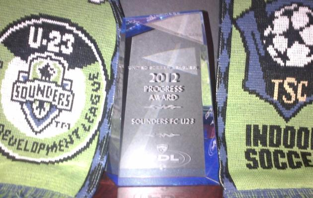 The Sounders FC U-23 displays their Progress Award from the 2012 PDL season.