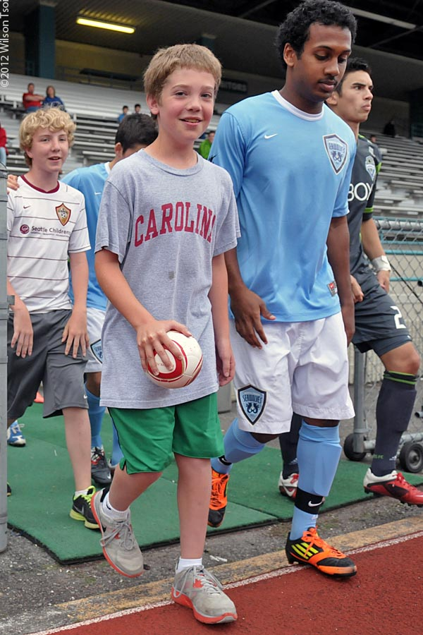 Local youth take the pitch with the SeaWolves at a 2012 home match. (Wilson Tsoi)