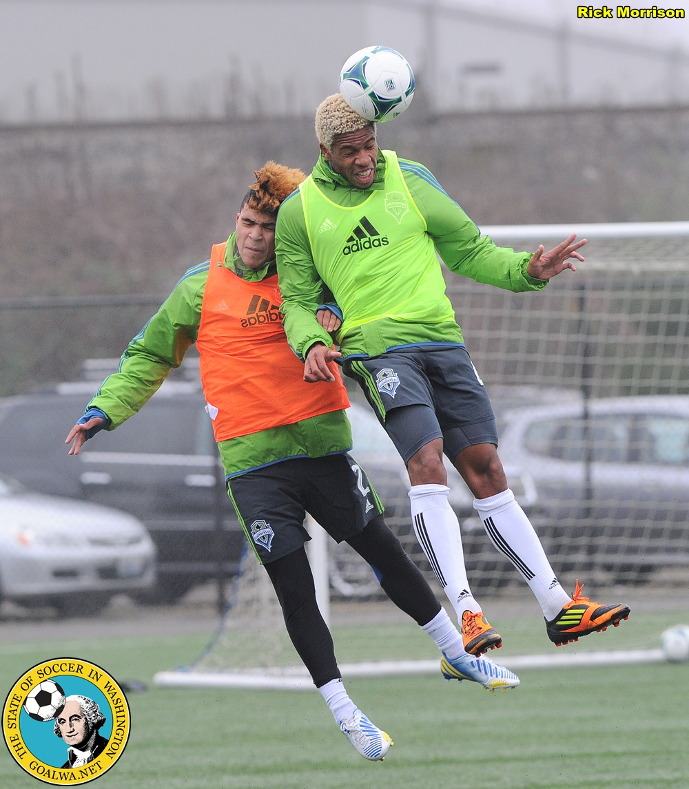 Bad hair header battle: DeAndre Yedlin jumps with invitee Travis Bowen of the Ventura County Fusion. (Rick Morrison)