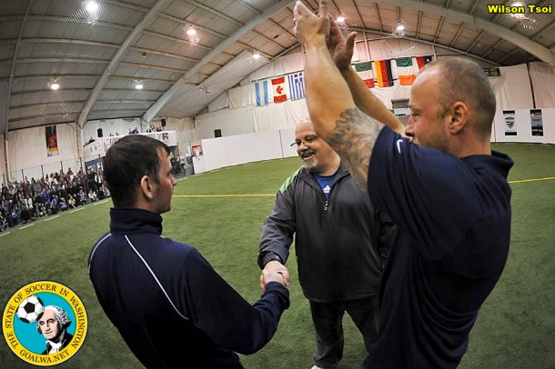 David Falk, center, shakes hands with South Sound head coach Jason Gjertsen as John Crouch, Shock manager raises his hands in applause. (Wilson Tsoi)