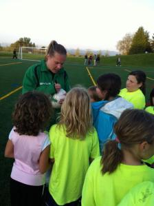 Casey Barrier signs for kids after an ECFC practice in 2012. (ECFC photo)