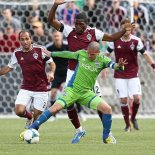 Seattle's Ozzie Alonso is surrounded by Rapids in Saturday's 1:0 victory over Colorado. (Sounders FC)