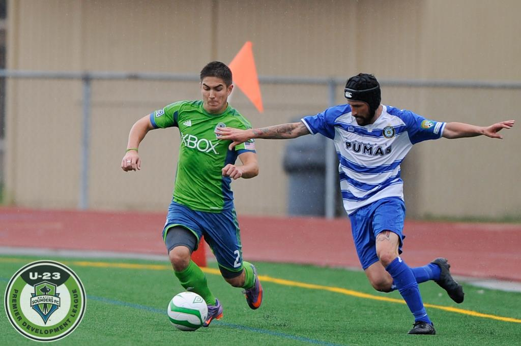 Michael Uyehara of the U23's and Kyle Johnson on the Pumas battle on the Curtis High pitch. (Chris Coulter, SoundersU23.com)