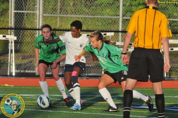 Kennya Cordner is blanketed by two Emerald City FC defenders. Other times she broke free as her side took their home opener. (Dale Garvey)