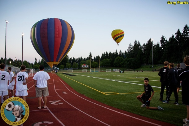 Players were still milling about the pitch when balloons descended on Redmond High School's stadium. (Cory Parris)