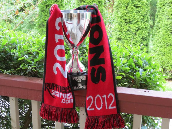 The inaugural Ruffneck Cup (2012) trophy sits in the Kitsap Pumas offices. You can see red and black scarves mingling at Pumas matches. This year the scarves will be in the winning side's colors. (David Falk)