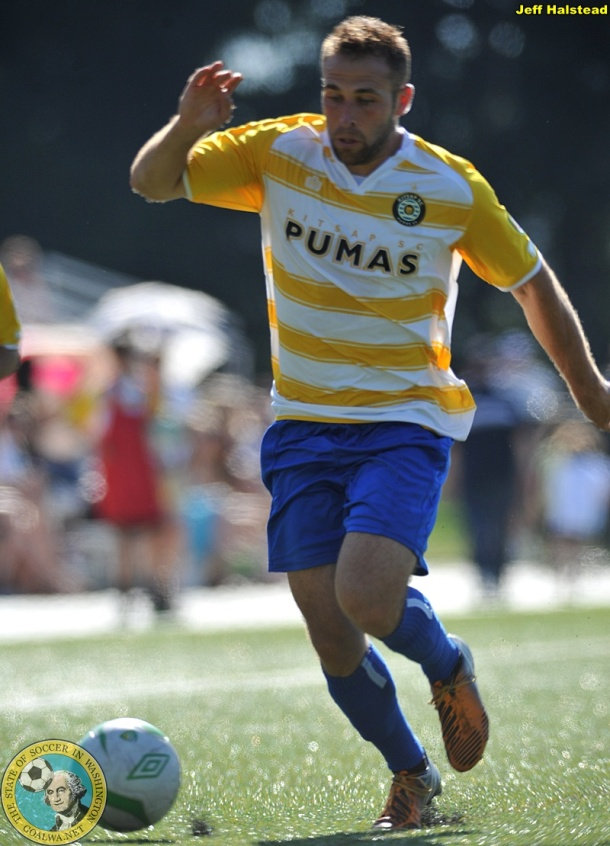 Mix and match: The Pumas had players in blue and yellow hoops. Here Neil Schaffer shows off the 'bumble bee' shirt. (Jeff Halstead)