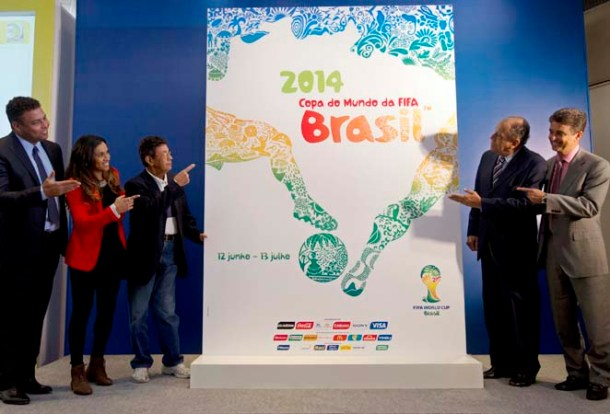 Brazil's former soccer player Ronaldo, left, current soccer player Marta, second from left, and former soccer players, from left, Amarildo, Carlos Alberto Torres and Bebeto present the logo of 2014 FIFA World Cup soccer tournament during a press conference in Rio de Janeiro, Brazil, Wednesday, Jan. 30, 2013. (AP Photo/Silvia Izquierdo)