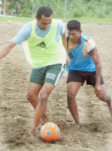 Hassan (left) at practice for Fiji Beach Soccer)