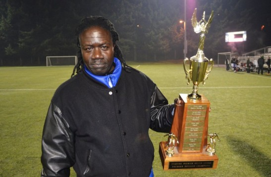 Stars head coach Alex Kajumulo with the SPSL trophy. (club photo)