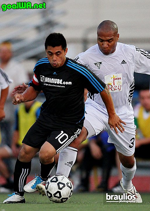 Seattle Stars FC (black) v. Yakima United FC (white), 2011. See gallery here. (Braulio Herrera)