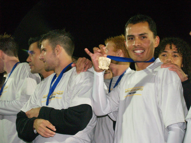 Hugo Alcaraz-Cuellar, far right, shows off his 2007 USL Champions medal with the Seattle Sounders. (Jenni Conner)