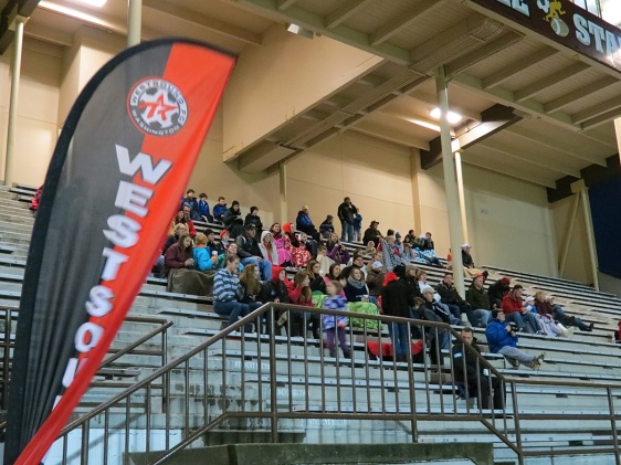 Fans huddle under the Silverdale Stadium roof as the WestSound FC Men host a fundraiser match in the pouring rain in Kitsap County on Saturday night. (David Falk)