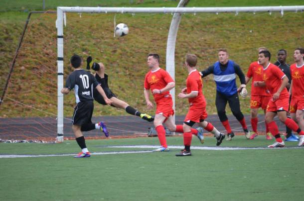 Seattle Sporting (wearing black) gets the only goal they would need to top Inter United FC in NPSL US Open Cup qualifying. (Sporting Facebook)