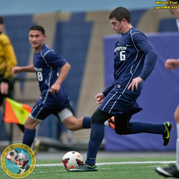 Mason Robertson (#6, at right) scored in the first half for the Huskies. (Wilson Tsoi)
