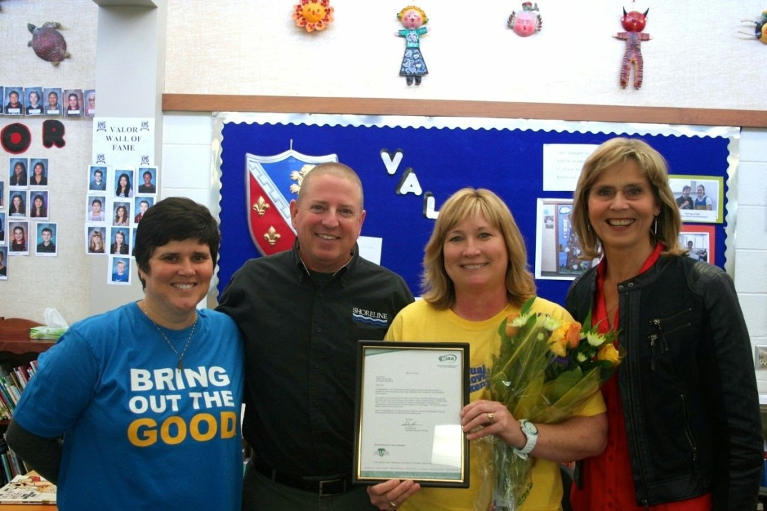 From left: Kellogg Middle School Principal Lisa Gonzalez Scott,  District Athletic Director Don Dalziel, Lori Henry, and  Shorewood Athletic Director and teacher Vicki Gorman. (School photo)