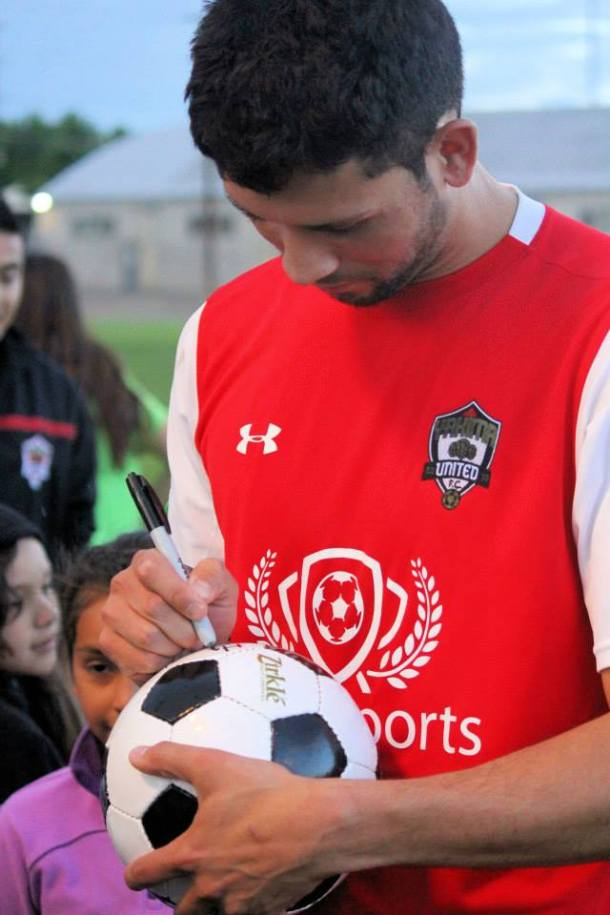 Valdovinos signing soccer balls for fans after a recent home match. (Tracie Fowler)