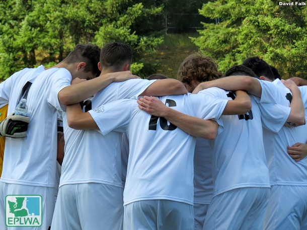 WestSound FC Men huddle before kickoff. The EPLWA brought playing opportunities to the peninsula in 2014. (David Falk)