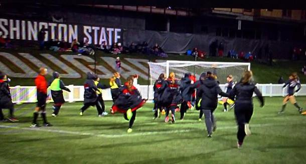 Seattle U players rush the field after the Redhawks scored in overtime to eliminate the WSU Cougars and advance in the NCAA's. (Facebook capture)
