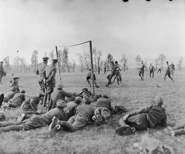 While no actual photos of the Christmas Truce soccer match(es) exist, there are photos of soldiers of WWI playing the sport.