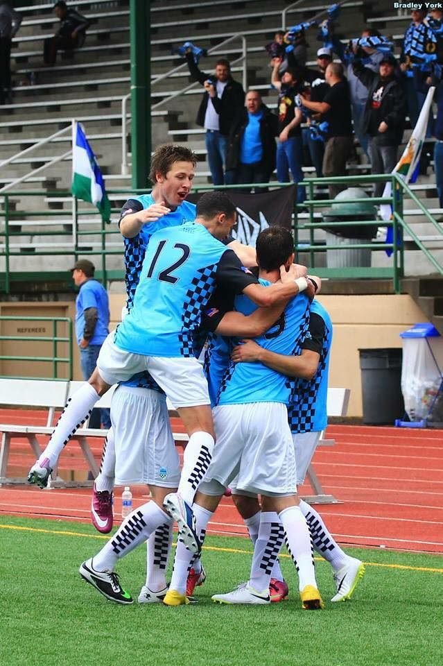 Strawn (#12) leaps into the celebration after a Victory goal. (Bradley York)