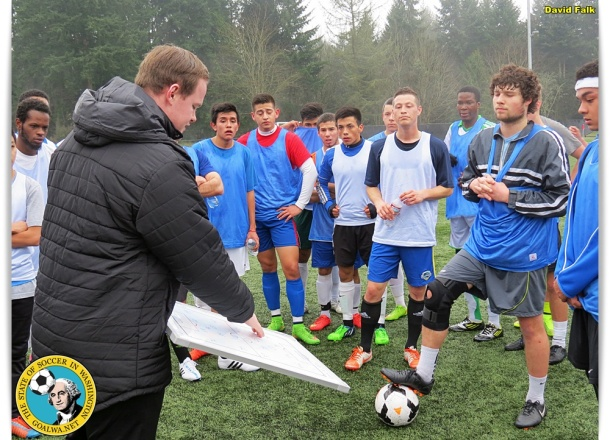 Cameron MacDonald gives instructions to one set of players. (David Falk)