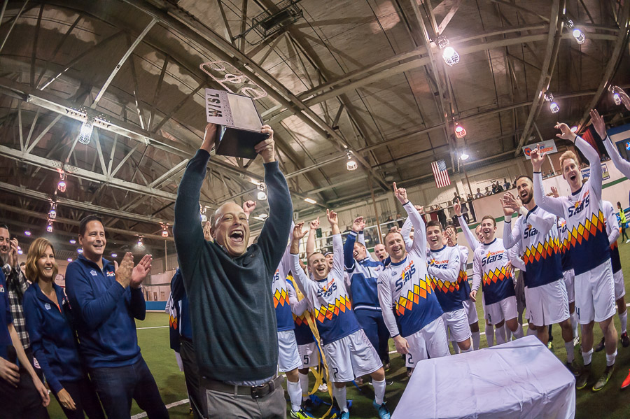 John Crouch must be exhausted! He founded the WISL, GM'ed the Stars, and helped run both the MASL transition and PASL (South Sound Shock) fill-in. Raise that trophy, John! (Wilson Tsoi)