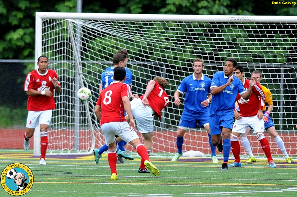 Timmy Meuleer (middle) fires home one of his three first half goals for Lane United. (Dale Garvey)