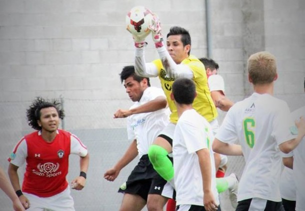 Mauricio Sanchez of Wenatchee grabs the ball. (Amanda Freisz.)