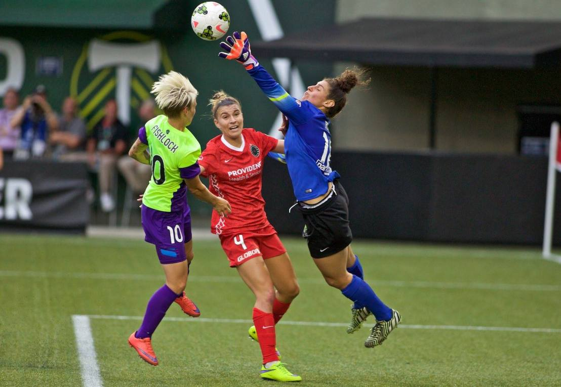 Reign FC win before over 21,000 fans in Portland