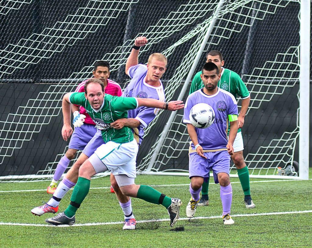 Sequim (purple) versus Port Angeles (green) in the Super Cup. (JR Kline photo)