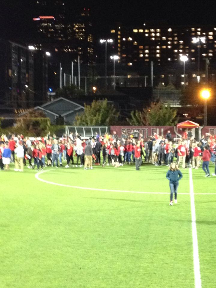 SU students flood the pitch after the Redhawks beat #10 Washington. (school Facebook)